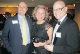 ??  ?? Alberta Party leader Greg Clark, left, with pals CSI's Kathryn Kaldestad and KPMG's Chris Day at the Immigrants of Distinction Awards.