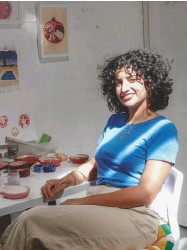 ??  ?? ABOVE Yasmin's vividly coloured pomegranate and fig dishes LEFT Yasmin – shown here in her studio – is from an Iranian and Turkish Cypriot background and is keen on exploring the role food has played in her heritage and in her work