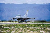?? STACY JONSGAARD/U.S. AIR FORCE ?? An F-16 prepares to take off from Holloman Air Force Base, near Alamogordo. Base officials are holding public meetings on plans to change the base's airspace for pilot training.