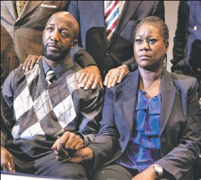 """?? By Evan Vucci, Afp/getty Images ?? """"We just wanted an arrest:"""" The parents of Trayvon Martin, Sybrina Fulton, right and Tracy Martin watch Florida state attorney Angela Corey's news conference Wednesday."""
