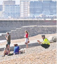 ?? GLYN KIRK/AFP VIA GETTY IMAGES ?? As the U.K. coronavirus death toll nears 9,000, people are being urged to stay away from beaches and parks.