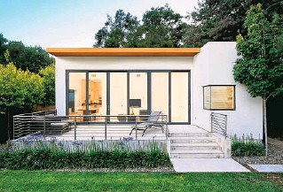 ?? DAVE EDWARDS ?? The pandemic has pushed the demand for accessory dwelling units, or ADUs, like this one in Palo Alto, California, designed by Maydan Architects. They fill an increased need for affordable housing or a separate home office. Fortunately, more city and state regulations are allowing them.