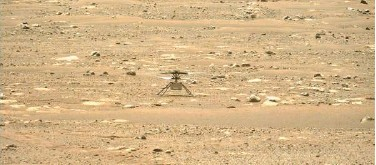 ?? Agence France-presse ?? ↑ Nasa photo obtained on Sunday shows the agency's Ingenuity Mars Helicopter after it successfully completed a high-speed spin-up test.