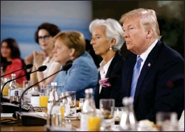 ?? Bloomberg photo by Cole Burston ?? Pres­i­dent Don­ald Trump lis­tens dur­ing a Group of Seven meet­ing Satur­day in Que­bec.