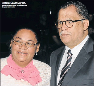 ??  ?? STANDING BY HER MAN: Roxanne Jordaan and husband Danny, whose every move has been scrutinise­d over the past few weeks