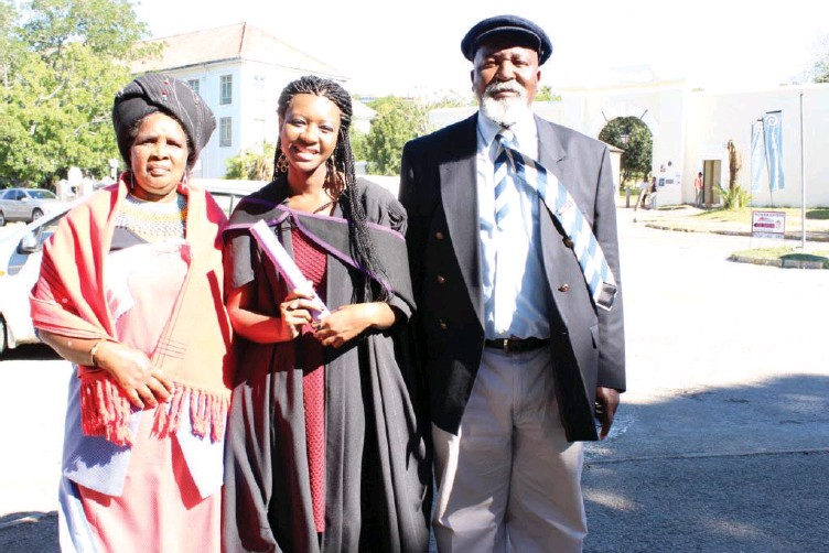 ?? Photo: Sue Maclennan ?? BA graduate (with distinction in Sociology) Leya Mgebisa on her way to celebrate after yesterday's graduation ceremony with her parents Cynthia Mgebisa and Yoshua Mgebisa. They live in Philippi, Cape Town. 'Overwhelmed, relieved' was how Leya felt -...