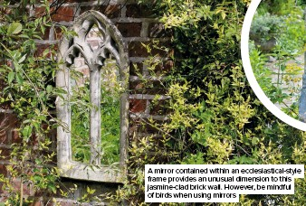 ??  ?? A mirror contained within an ecclesiastical-style frame provides an unusual dimension to this jasmine-clad brick wall. However, be mindful of birds when using mirrors