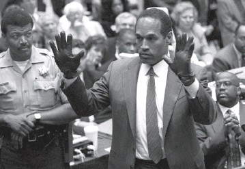 ??  ?? Simpson shows the jury a new pair of Aris extra-large gloves, similar to the gloves found at the Bundy and Rockingham crime scene June 20, 1995, during his double murder trial in Los Angeles, California, on June 20, 1995. (Right, top) Official booking photograph of Simpson on June 17, 1994; and (right) prosecutor Christopher Darden holds a smiling portrait of murder victim Nicole Brown to contrast it with photos of a battered Nicole shown to the jury during closing arguments in the Simpson double murder trial on Sept 25, 1995. — AFP
