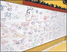 ?? CONTRIBUTE­D PHOTO ?? Scrolls with well wishes from folks in Maryland hang on the walls at a military base in Afghanista­n.