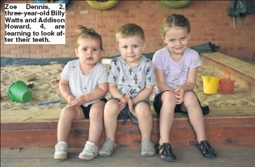 ??  ?? Zoe Dennis, 2, three-year-old Billy Watts and Addison Howard, 4, are learning to look after their teeth.