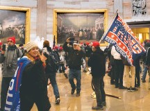 ?? SAUL LOEB/AGENCE FRANCE-PRESSE/GETTY IMAGES ?? Jenny Cudd, left, and other supporters of President Trump breach security and enter the U.S. Capitol Rotunda on Wednesday.