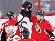 ?? FRED CHARTRAND/The Canadian Press ?? Ottawa Senators Milan Michalek, right, and Mark Stone celebrate a goal against Calgary on Sunday. After being written off, the Senators are making a late playoff push in the East.