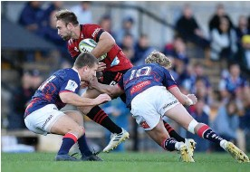 ?? Photo / Getty Images ?? Crusaders back Braydon Ennor is sandwiched in Sydney.