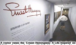 ?? AP ?? A visitor views the 'Ernest Hemingway: A Life Inspired' exhibition, featuring books and belongings from the archives of the renowned author, at the John F. Kennedy Presidential Library and Museum in Boston on Thursday.