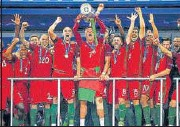 ?? GETTY IMAGES ?? Cristiano Ronaldo lifts the trophy after Portugal beat France in the Euro 2016 final at the Stade de France in Paris.
