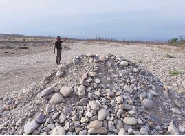 ?? PHOTO: GEETANJALI KRISHNA ?? A pile of stones left behind during a raid in Choi. Today, nine sand stockpiles in Choi have destroyed land that was once fertile and productive