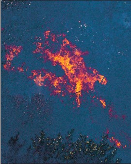 ?? RANDY VAZQUE — STAFF PHOTOGRAPHER ?? Vegetation burns as hot spots flare up near Watsonville on Tuesday.