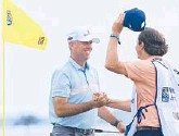 ?? SAM GREENWOOD/GETTY ?? Stewart Cink celebrates with his caddie and son, Reagan, after winning the Heritage on Sunday. It was the 47-yearold's second win of the season.