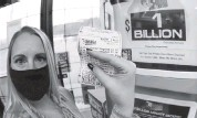 ?? KEITH SRAKOCIC AP ?? A patron, who did not want to give her name, shows the ticket she just purchased for the Mega Millions lottery drawing Friday at the lottery ticket vending kiosk in a Smoker Friendly store in Cranberry Township, Pa.