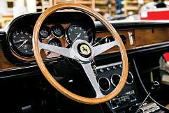 ??  ?? ABOVE: Wood dashes and steering wheels are restored and sometimes crafted in-house. BELOW: Bolts of fabric and leather are kept on hand, tagged according to customer. OPPOSITE PAGE: Vintage automobile restorer Bob Smith in front of a 1960 Ferrari...