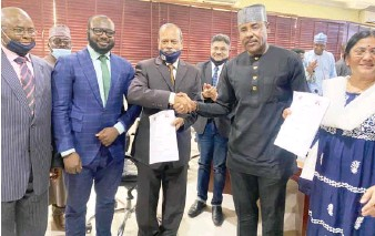 ??  ?? MD/CEO of Kano Electricity Distribution Company (KEDCO), Dr Jamil Isyaku Gwamna (2nd right) shake hands with the Vice Chancellor, Skyline University Nigeria, Dr. Sudhakar Kota, after signing MoU to enhance training and education between both parties in Kano recently.