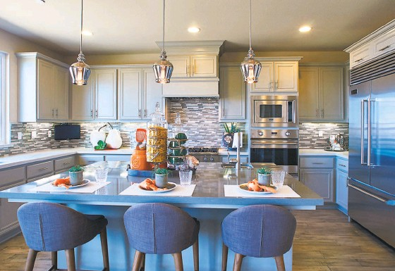 ?? Signature Homes ?? The open floor plans feature sleek kitchens designed for entertaining.