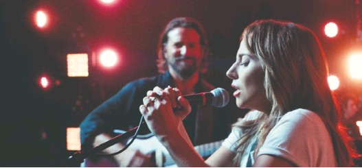 ?? WARNER BROS. ?? The music in the Academy Award-winning A Star Is Born, starring Bradley Cooper, left, and Lady Gaga, stirred something in Mike Boone when he watched the movie recently.