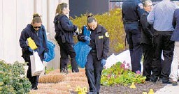 ?? A J MAST/THE NEW YORK TIMES ?? Crime scene technicians investigate the grounds Friday at a FedEx warehouse in Indianapolis where authorities say Brandon Scott Hole, a former employee, fatally shot eight people Thursday night before taking his own life.