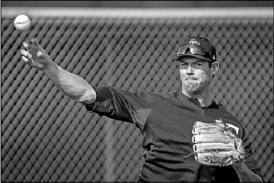 ?? Smiley N. Pool/Staff Photographer ?? Doug Fister participates in pitchers fielding practice during a spring training workout at the Rangers' training facility in Surprise, Ariz. Fister, who revived his career with Boston last season, is one of three newcomers upon whom the Rangers are...