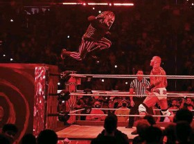 ?? Photos by LUIS SANTANA | Times ?? Bray Wyatt makes a leaping entrance into the ring, with the perfect mood lighting.