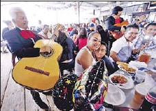 ??  ?? MARIACHIS play for Ariana Guevara as she celebrates her birthday at the market, which has been at its current location since 1982.