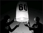 ?? By Brendon Thorne, Getty Images for WWF ?? Countdown: Lanterns are released over Sydney. On Saturday, everyone is asked to switch off lights for an hour at 8:30 p.m. for Earth Hour.