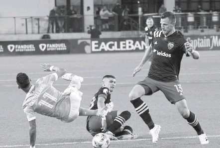 ?? PHOTOS BY TONI L. SANDYS/THE WASHINGTON POST ?? Frédéric Brillant, right, Joseph Mora and D.C. United unveiled a pressing, proactive style against Valentín Castellanos and NYCFC.