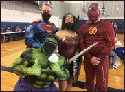 ?? EVAN BRANDT — MEDIANEWS GROUP ?? From left, Superman (Paul Winterbottom), Wonder Woman (Megan Luckett), The Flash (Phil Mest) and a recently vaccinated Hulk (Kate Luckett) were on hand Friday to lift spirits and support the vaccination effort.