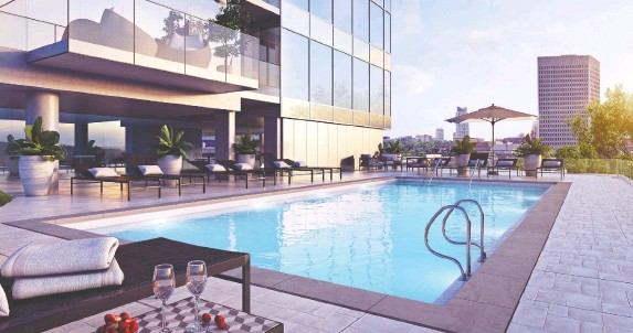 ??  ?? Amenities at The Dale include an outdoor pool atop the podium, with barbecues, lounging and room for dining.