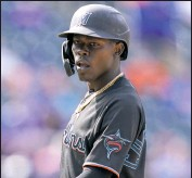 ?? AP PHOTO ?? Miami's Jazz Chisholm Jr. stands at first after being walked by Mets relief pitcher Edwin Diaz in the ninth inning Saturday.