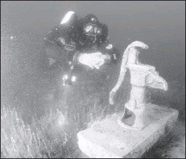 ??  ?? Dixon discovered a water pump at the submerged town of Minnewanka Landing in Banff National Park. It's just one of the underwater sites found in Alberta and B.C.