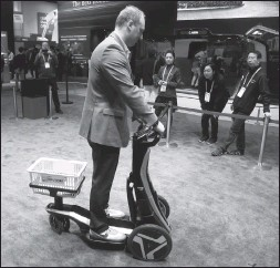?? Associated Press photo ?? A patron uses the AISIN ILY-A Shopping Mobility Partner scooter at the AISIN booth during the CES tech show in Las Vegas.