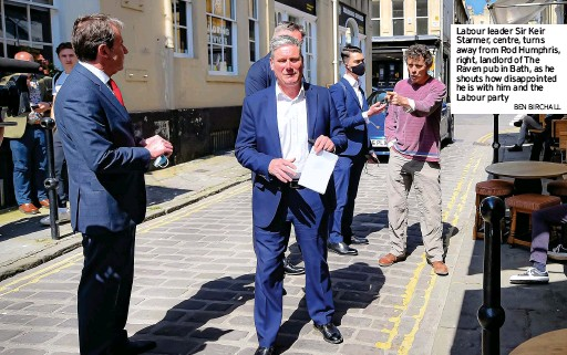 ?? BEN BIRCHALL ?? Labour leader Sir Keir Starmer, centre, turns away from Rod Humphris, right, landlord of The Raven pub in Bath, as he shouts how disappointed he is with him and the Labour party