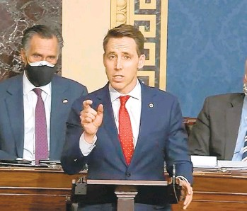 ??  ?? Josh Hawley, R- Mo., speaks during a Senate debate session to ratify the 2020 presidential election at the U.S. Capitol on Wednesday in Washington, D.C.