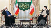 ??  ?? President Hassan Rouhani, above left, and president-elect Ebrahim Raisi. Below, supporters of the new leader