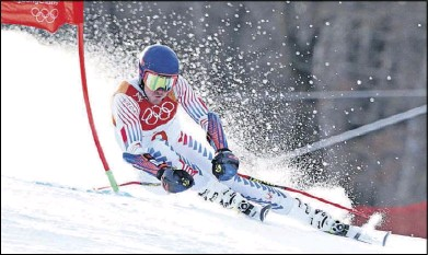 ?? Christophe Pallot/Agence Zoom/Getty Images ?? Ted Ligety competes in his opening run in the men's giant slalom. His time of 1 minute, 10.71 seconds put him in 20th place, 2.44 seconds behind leader Marcel Hirscher of Austria.