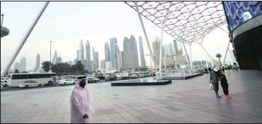 ?? PHOTO: AP ?? A view of the skyline of Dubai, the main port city of the United Arab Emirates. The crisis between tiny Qatar and its Arab neighbour is straining the centuries-old cultural and family fabric that binds the energy-rich Gulf states into a common culture,...