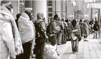 ?? Karen Warren / Staff photograph­er ?? The city opened the George R. Brown Convention Center as an emergency shelter for homeless people to get out of the freezing temperatur­es. Many organizati­ons continue to offer help.