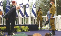 ?? (Mark Neyman/GPO) ?? PRESIDENT REUVEN RIVLIN honors an outstanding soldier during an Independence Day event yesterday.