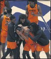 ?? KATHLEEN BATTEN — AP ?? Oklahoma State guard Avery Anderson III, center, celebrates with his teammates after their upset win over West Virginia.