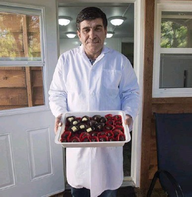 ?? ANDREW VAUGHAN/THE CANADIAN PRESS ?? Syrian refugee Isam Hadhad owned a successful chocolate company in the Middle East before the war destroyed his factory.