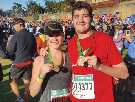 ?? Photo: Supplied ?? Rhodes students Samantha Hultum and Stephen Pettitt with their Half-marathon finishing medals.