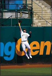 ?? JEFF CHIU — THE ASSOCIATED PRESS ?? The A's Seth Brown catches a fly out hit by the Dodgers' Austin Barnes during the fourth inning on Wednesday.