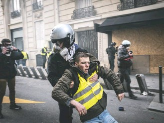"""?? VERONIQUE DE VIGUERIE FOR THE WASHINGTON POST ?? What started as opposition to a carbon tax turned into a revolt directed at French President Emmanuel Macron in Paris, where """"yellow vest"""" protesters have clashed with police along the Champs-Elysees."""